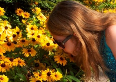 Picture of Intersex Woman Smelling Flowers