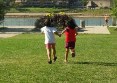 Intersex Children Running In Park