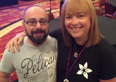 Male & Female Intersex Friends Arms On Shoulders